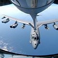 A Kc-135 Stratotanker Refuels A B-52 Poster by Stocktrek Images
