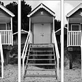 Beach hut triptych Poster by John Edwards