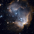 Bright Blue Newborn Stars Blast A Hole Print by ESA and nASA