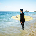 Business man at the beach with surfboard Print by Brandon Tabiolo - Printscapes