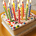 Candles on birthday cake Print by Garry Gay