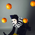 Circus fashion mime juggles with five oranges. Photo. Poster by Kireev Art