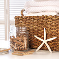 Closeup of laundry basket with fine linens  Print by Sandra Cunningham