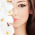 Closeup on beautiful face with flowers Print by Anna Omelchenko