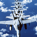 Fa-18c Hornet Aircraft Fly In Formation Poster by Stocktrek Images