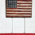 Folk art American flag on wooden wall Poster by Garry Gay