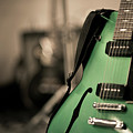 Green Electric Guitar With Blurry Background Poster by Sean Molin - www.seanmolin.com