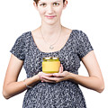 Holistic naturopath holding jar of homemade spread Poster by Ryan Jorgensen