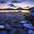 Ice Flakes Drifting Against The Sunset Print by Arild Heitmann