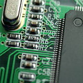 Integrated circuit on a computer USB board Poster by Sami Sarkis