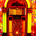 Juke box with Christmas lights Print by Garry Gay