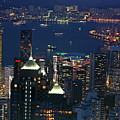 Kowloon skyline and Victoria Harbour at dusk Poster by Sami Sarkis
