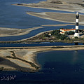 La Gacholle Lighthouse surrounded with blue sea in Camargue Print by Sami Sarkis