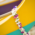 Lei draped over outrigger Poster by Dana Edmunds - Printscapes