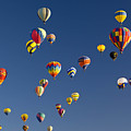 Many Vividly Colored Hot Air Balloons Print by Ralph Lee Hopkins