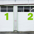 Numbers On Repair Shop Bay Doors Poster by Don Mason