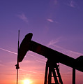 Oil Rig At Sunset Print by Connie Cooper-Edwards