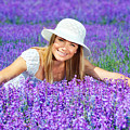 Pretty woman on lavender field Poster by Anna Omelchenko