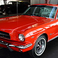 Red 1965 Ford Mustang . Front Angle Print by Wingsdomain Art and Photography