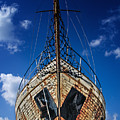 Rusting boat Print by Stylianos Kleanthous