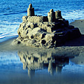 Sandcastle on beach Poster by Garry Gay