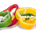 sliced colorful peppers Poster by Meirion Matthias