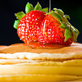 Strawberry butter pancake with honey maple sirup flowing down Print by Ulrich Schade