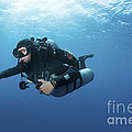 Technical Diver With Equipment Swimming Print by Karen Doody
