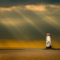 the lighthouse as the storm breaks Print by Meirion Matthias