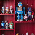 Toy robots on shelf  Poster by Garry Gay