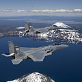 Two F-15 Eagles Fly Over Crater Lake Poster by HIGH-G Productions