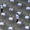Waiters at empty cafe terrace on Piazza San Marco Poster by Sami Sarkis