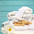 White  basket with laundry Print by Sandra Cunningham